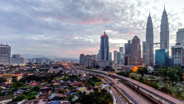 Dramatic-sunrise-at-Kuala-Lumpur-city-Moving-and-changing-color-clouds-Aerial-view-