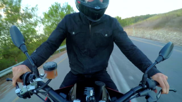 POV-footage-of-man-riding-a-red-sports-motorcycle-on-a-curved-road