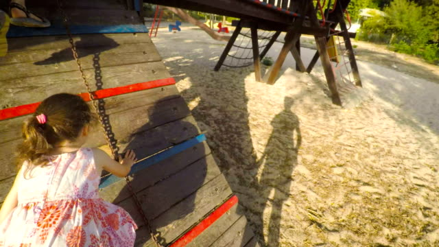 POV-footage-of-three-kids-playing-in-a-playground