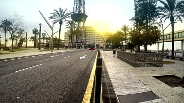 Tour-bus-takes-tourists-on-city-tour-at-sunset