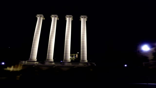 Four-white-columns-near-Royal-palace-at-n-ight-in-Barcelona-Spain