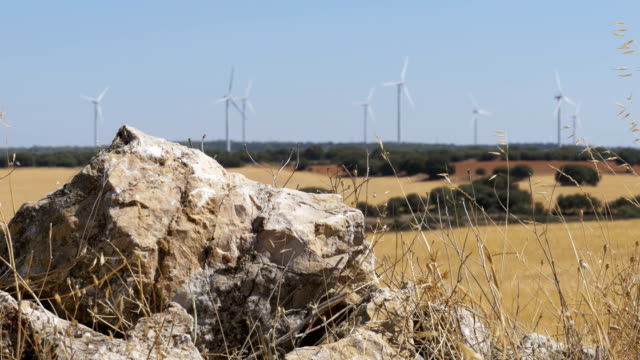 Wind-Turbines-on-a-Background-of-Stone-in-the-Desert-of-Spain