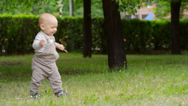Baby-Boy-Taking-First-Steps-in-Park