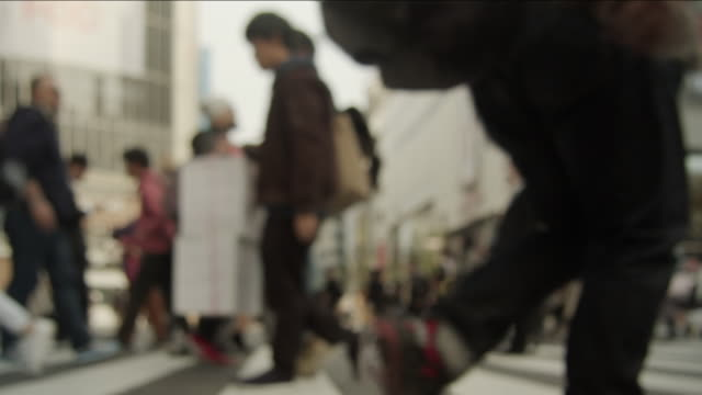 Slowmotion---People-walking-in-the-scrambled-intersection-in-Shibuya