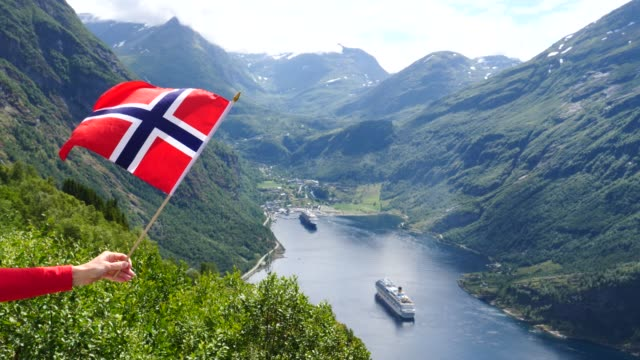 """Norwegian-flag-and-cruise-ship-on-fjord""""-"""