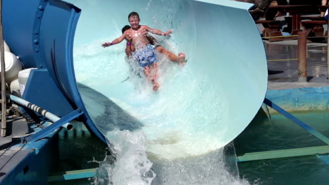 Slow-motion-of-2-happy-boys-sliding-on-water-slide-Cape-Town-South-Africa