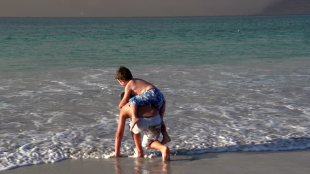 2-young-boys-playing-in-the-shallow-sea-water-Cape-Town