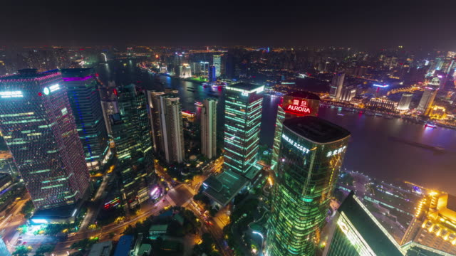 china-shanghai-cityscape-night-illumination-roof-top-arial-panorama-4k-time-lapse