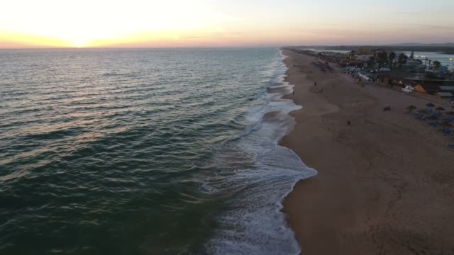 Flying-above-the-Faro-beach-(Praia-de-Faro)-during-sunset-Algarve-Portugal