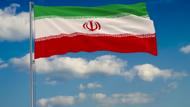 Flag-of-Iran-against-background-of-clouds-floating-on-the-blue-sky