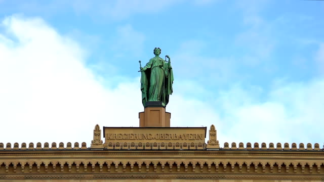 Historical-statue-atop-district-government-of-Upper-Bavaria-in-Munich-Germany