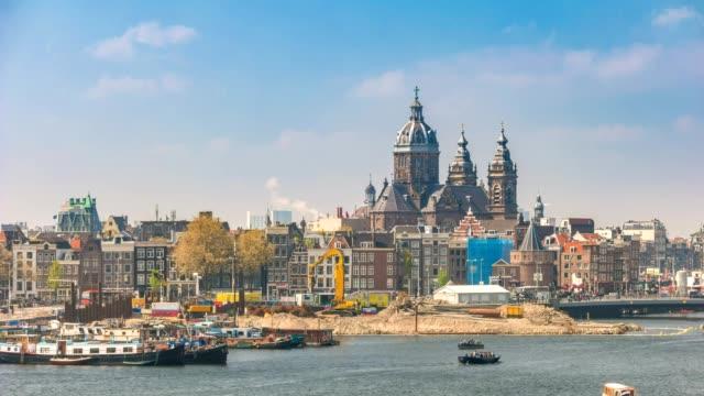 Amsterdam-city-skyline-timelapse-with-Basilica-of-Saint-Nicholas-Amsterdam-Netherlands-4K-Time-Lapse