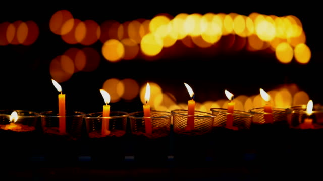 Candle-fire-flame-slow-motion-in-celebration-and-meditating-on-night-day