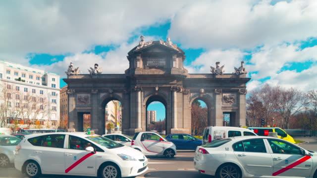 sunny-day-arch-de-triumph-traffic-circle-4k-time-lapse-madrid-spain