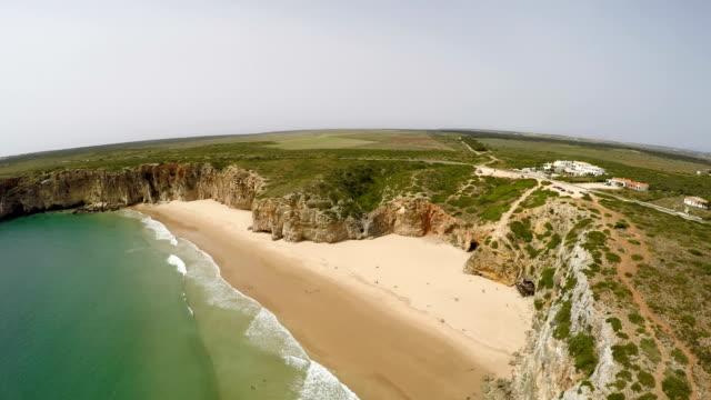 Aerial-video-footage-of-beautiful-bay-and-sandy-beach-of-Praia-do-Beliche-near-Cabo-Sao-Vicente-Algarve-region-Portugal