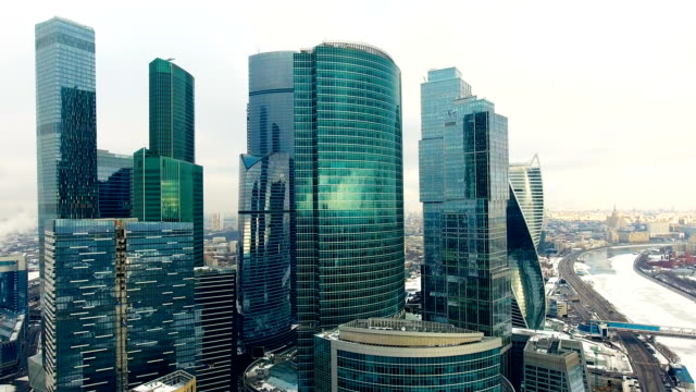 Skyscrapers-Office-windows-with-city-reflected-in-it-Nobody-Close-up-aerial-shot-