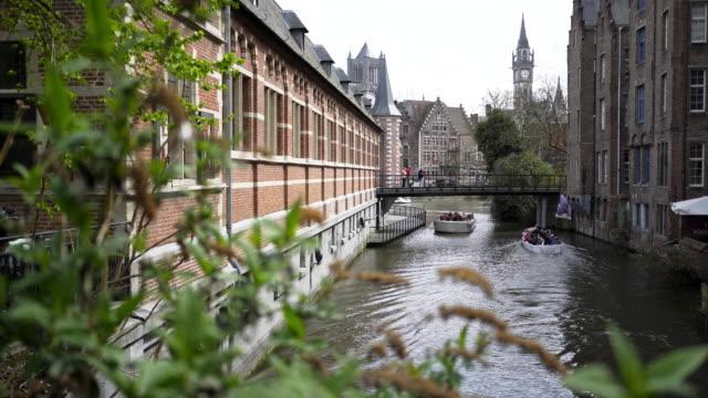 boats-floating-between-buildings