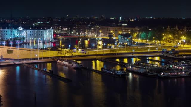 Países-Bajos-amsterdam-de-noche-base-panorama-superior-techo-4k-lapso-de-tiempo