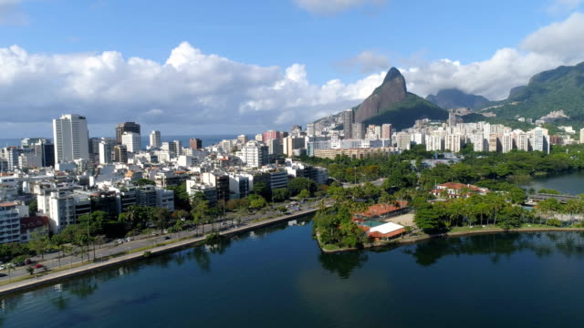 Flying-above-water-on-Ipanema-Beach-with-Mountains-in-the-distance-Rio-de-Janeiro