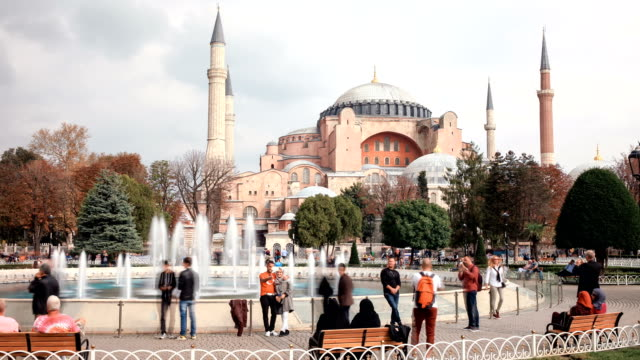 Tourists-walking-in-Sultanahmet-Square-Hagia-Sophia-a-former-Orthodox-patriarchal-basilica-later-a-mosque-and-now-a-museum-in-Istanbul-Turkey