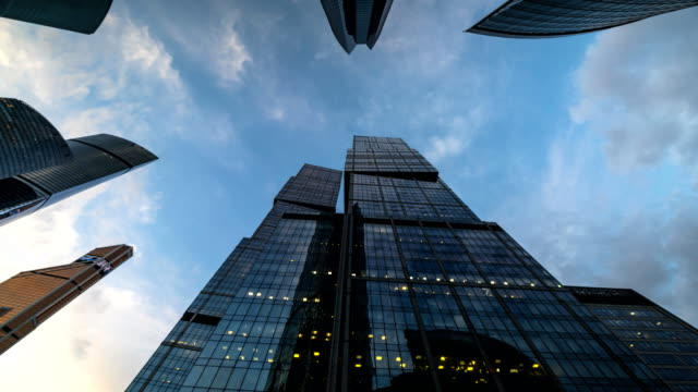 bottom-up-view-of-rotating-skyscrapers-and-flying-clouds-time-lapse-hyper-lapse