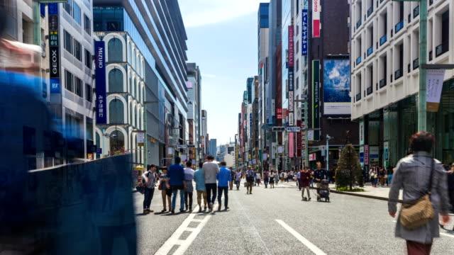 TOKYO-JAPAN-Pedestrians-walking-and-shopping-at-Ginza-district-