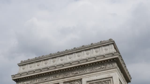 Highly-detailed-surface-of-Arch-of-Triumph-in-Paris-France-in-front-of-cloudy-sky-4K-3840X2160-30fps-UHD-tilt-footage---World-famous-Arc-de-Triomphe-de-Etoile-slow-tilting-4K-2160p-UltraHD-video
