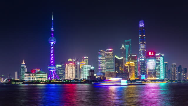 iluminación-nocturna-de-China-famoso-Shangai-panorama-ciudad-Bahía-4k-lapso-de-tiempo