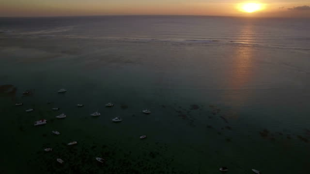 Aerial-view-of-yachts-at-anchor-and-ocean-at-sunset