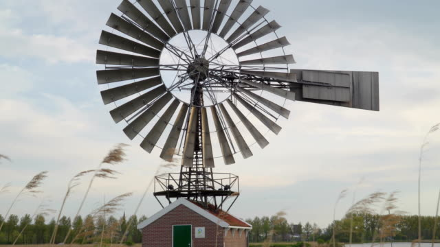 Closer-look-of-the-huge-windmill-across-the-river