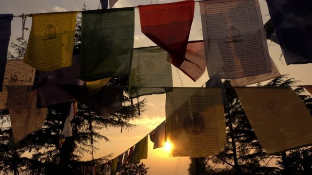 Video-of-some-Tibetan-prayer-flags-moved-by-the-wind-at-sunset-in-Kathmandu-Nepal-