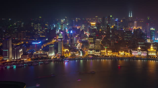 china-night-light-shanghai-old-city-bay-roof-top-aerial-panorama-4k-time-lapse