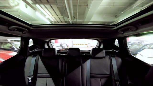 Outdoor-glass-roof-top-car-cabin-Driving-in-indoor-carpark-