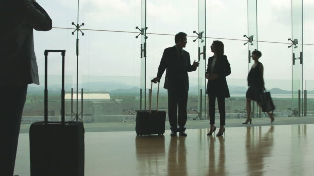 asian-businessman-and-businesswoman-talking-in-airport