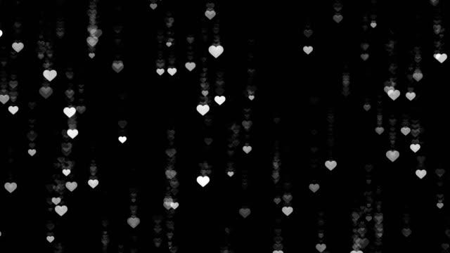 Heart-falling-rain-black-background