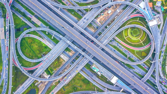 Aerial-view-Time-lapse-of-the-expressway-motorway-and-highway-in-the-detail-of-circus-intersection