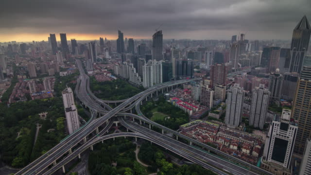 china-shanghai-cityscape-sunset-storm-sky-road-junction-city-panorama-4k-time-lapse