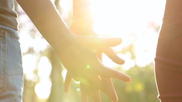 Joining-hands-together,-uniting-the-chain-from-hands-held-together-in-the-sunlight