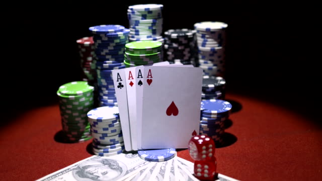 Four-aces-dollars-and-stack-of-gambling-chips-on-red-casino-table