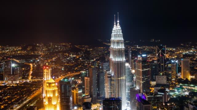 Time-Lapse---nocturno-en-la-ciudad-de-Kuala-Lumpur-Alto-ángulo/Aerial-View-Las-Torres-Petronas-Visible-
