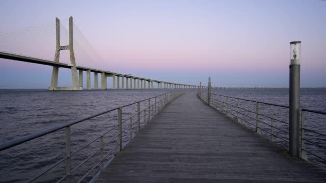 Ponte-Vasco-da-Gama-Bridge-view-from-a-pier-at-sunset