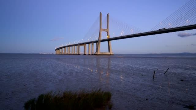 Ponte-Vasco-da-Gama-Bridge-view-near-the-Rio-Tejo-river-at-sunset