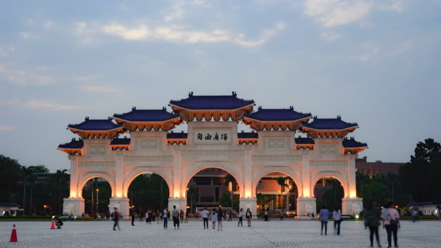 Dawn-at-Chiang-Kai-Shek-Memorial-Hall-The-main-gate-at-evening-with-unknown-tourists-walking-