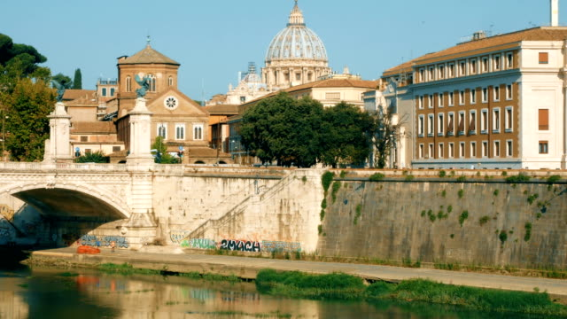 tracking-shot-from-the-Castel-Sant-Angelo-bridge-towards-the-dome-of-the-Vatican-Rome