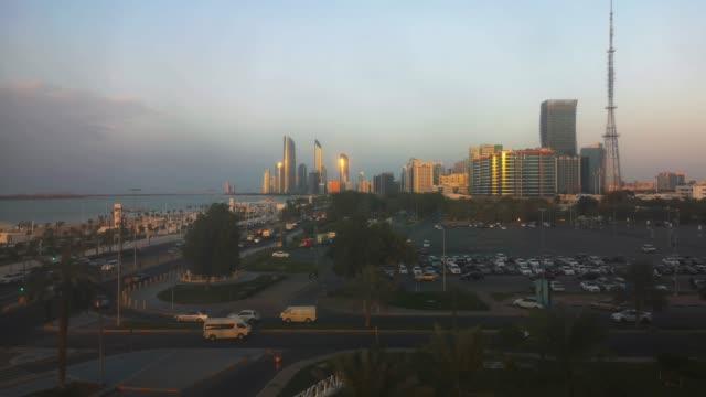 Beautiful-view-of-Abu-Dhabi-city-skyline-and-corniche-street-at-sunset