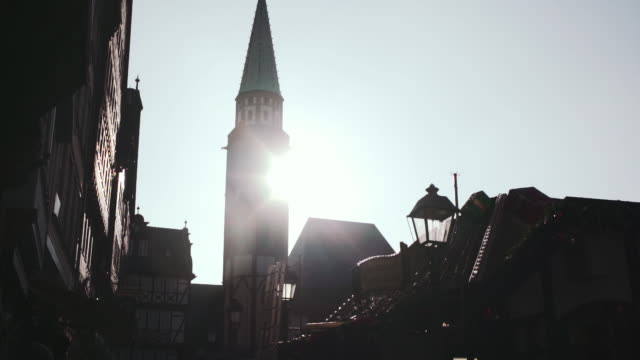 Old-St-Nicholas-Church-Tower-and-Frankfurt-Christmas-Market-Backlit-by-Sunlight