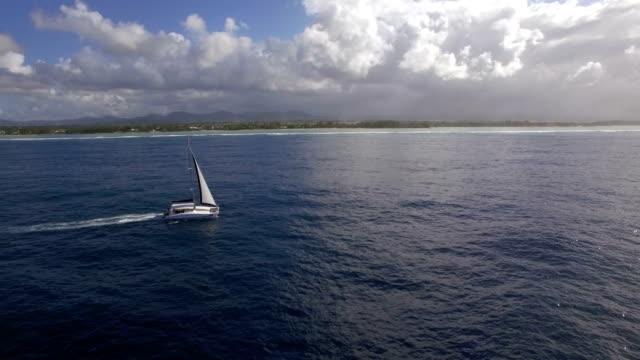 Sailing-yacht-and-island-coast-aerial-shot