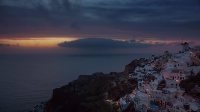 sunset-sky-santorini-island-oia-town-bay-coastline-panorama-4k-time-lapse-greece