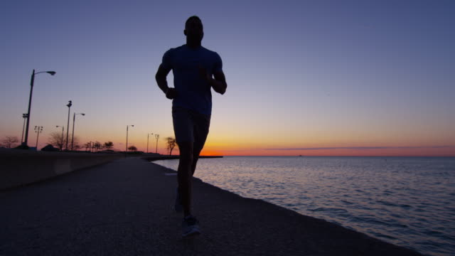 Ethnic-African-American-male-silhouette-running-at-sunrise