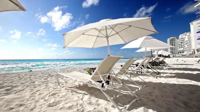 Caribbean-beach-with-sun-umbrellas-and-beds